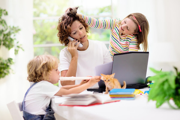 mom overwhelmed and burned out working from home with kids