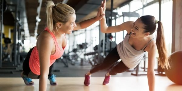 women happy working out