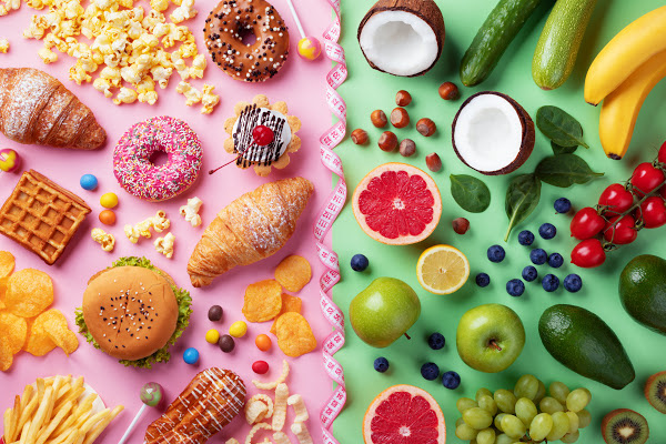 bright colored picture of healthy food on the right side with green background and unhealthy food on the left side with a bright pink background