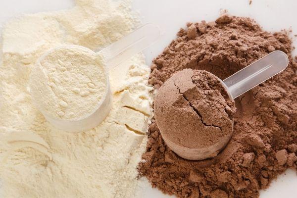 white vanilla protein powder and brown chocolate protein powder.