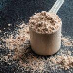 chocolate protein powder with a dark background