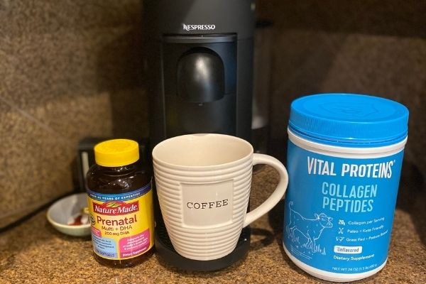 a coffee cup in a coffee maker with collagen protein and prenatal vitamins